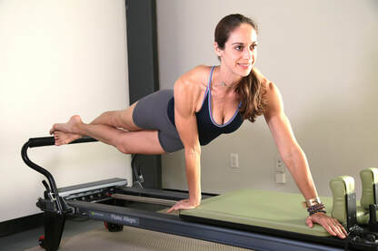 the pilates reformer builds core strength, flexibility and helps us to lose weight to boot
